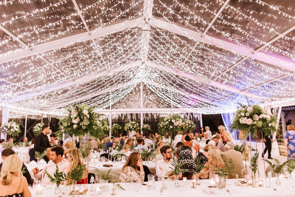Clear Marquee Decor Long Tables Greenery Foliage Ghost Chairs Fairy Lights Lighting Portugal Destination Wedding The Lovers Imagery
