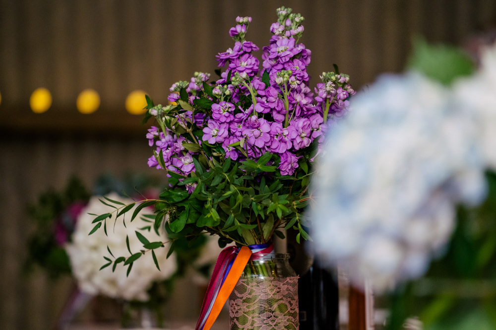 Flowers in Jars Eclectic Wedding Paul and Tim Photographers