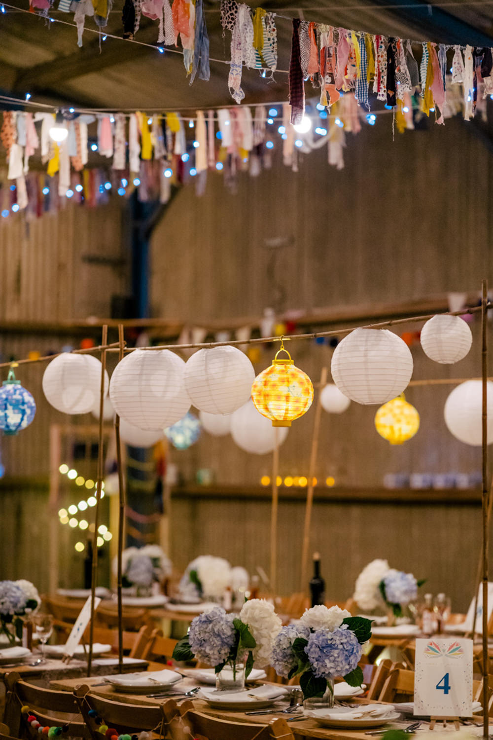 Rag Bunting Decor Barn Lanterns Fairy Lights Eclectic Wedding Paul and Tim Photographers