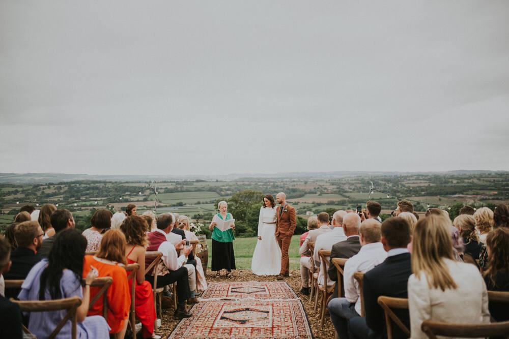 Outdoor Ceremony Rug Aisle Cross Back Chairs Pennard Hill Farm Wedding MT Studio