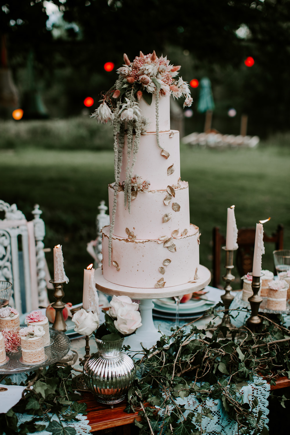 Cake Tall Iced Flowers Metallic Gold Leaves Candles Whimsical Wedding Ideas Charlotte Lucy Photography