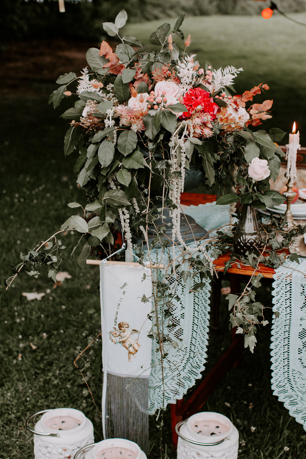 Table Flowers Centrepiece Greenery Red Pink Rose Hydrangea Berries Ivy Whimsical Wedding Ideas Charlotte Lucy Photography